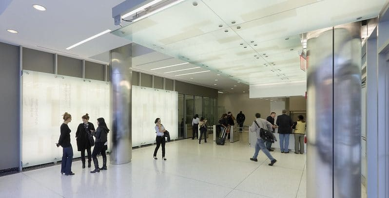 students walking inside campus building