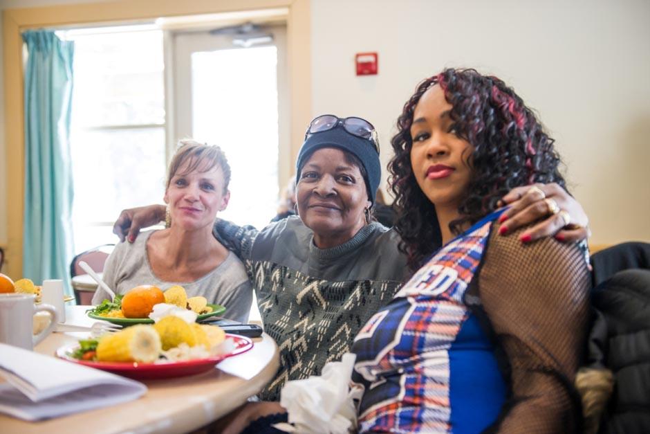 three woman sitting at a table