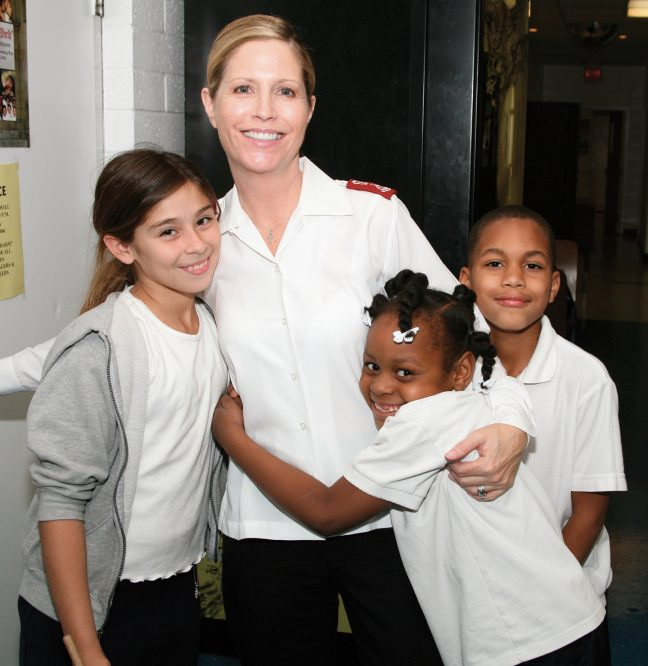 Salvation Army officer with children
